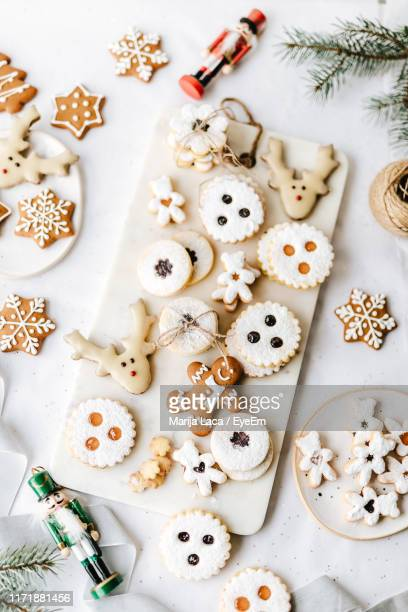 high angle view of christmas cookies on table - cookie stock pictures, royalty-free photos & images