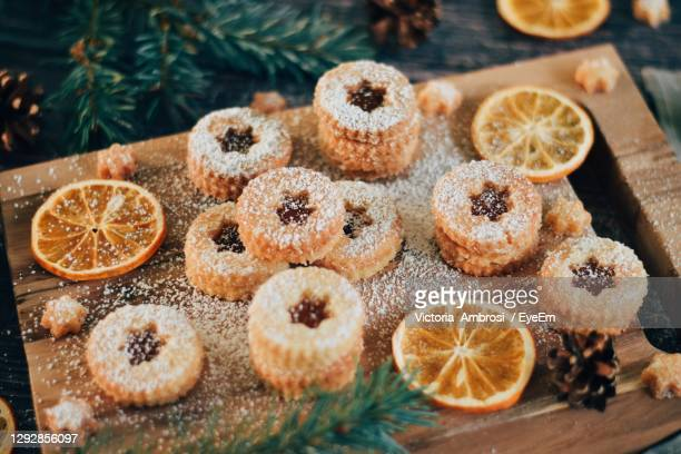 high angle view of christmas cookies on table - austria stock pictures, royalty-free photos & images