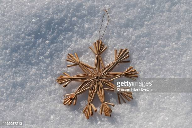 high angle view of christmas decoration on snow - christian hilse stock-fotos und bilder