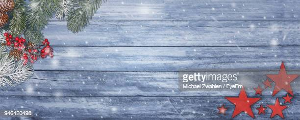 High Angle View Of Christmas Decoration On Table Against Wall
