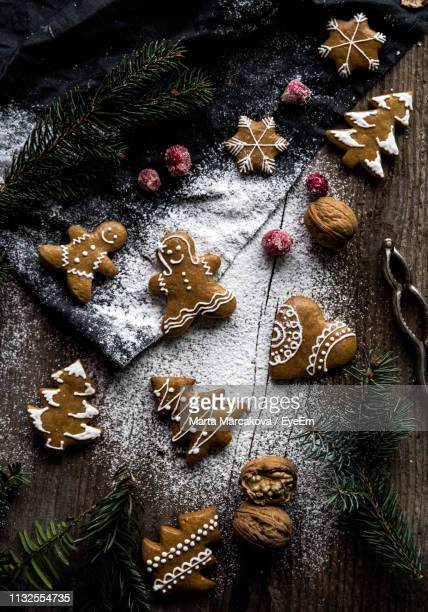 high angle view of christmas decoration on table - gingerbread cookie stock pictures, royalty-free photos & images