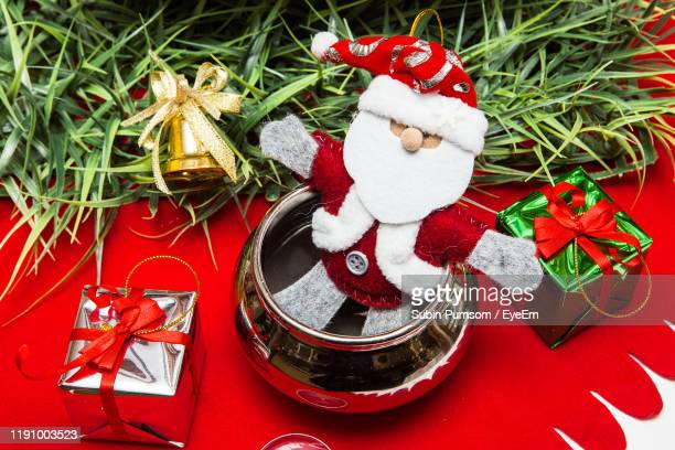 high angle view of christmas decoration - cartoon santa claus stock photos and pictures