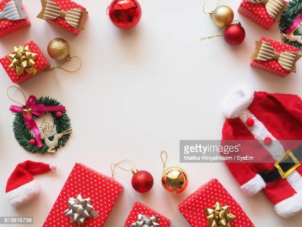 High Angle View Of Christmas Decorations And Gifts On Table