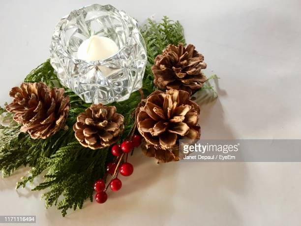 high angle view of christmas decorations on table - christmas decore candle stock pictures, royalty-free photos & images