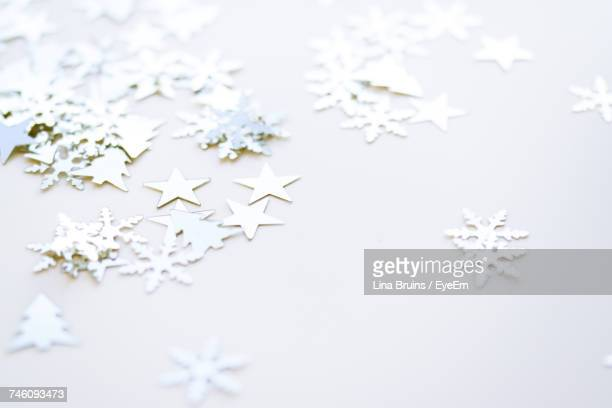 high angle view of christmas decorations on white table - white christmas stock photos and pictures