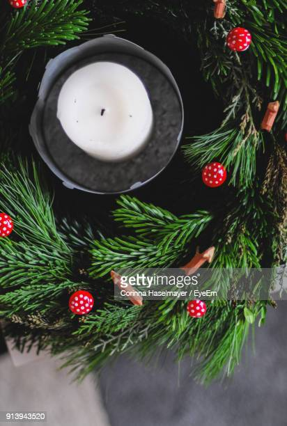 High Angle View Of Christmas Decorations With Candle