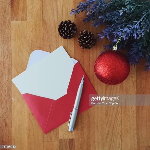high angle view of christmas greeting card with decorations on table - holiday card stock photos and pictures
