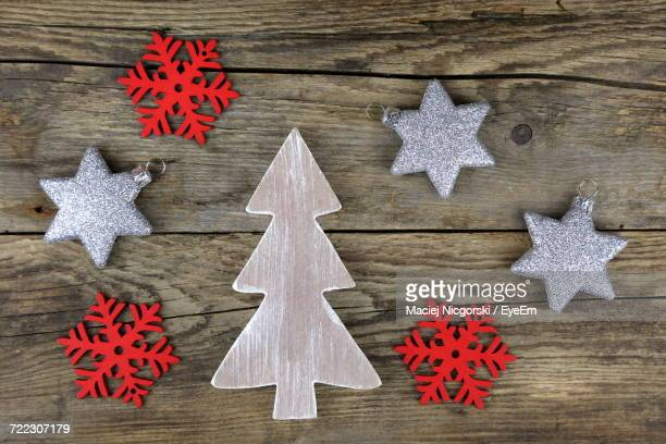 High Angle View Of Christmas Ornaments On Wooden Table