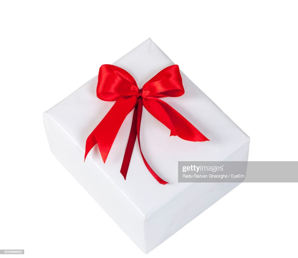 High Angle View Of Christmas Present Against White Background Stock ...