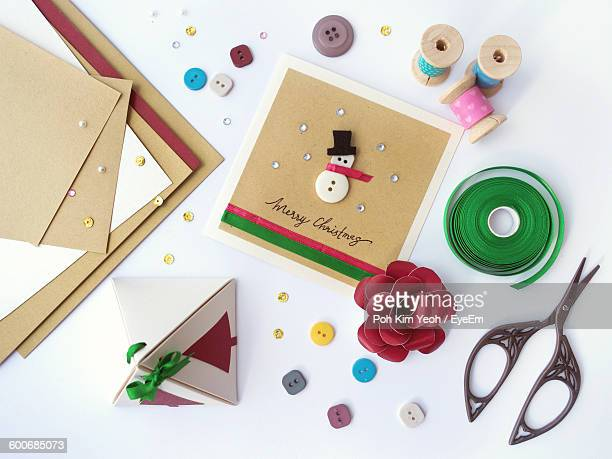 high angle view of christmas present and craft products on table - holiday card stock photos and pictures