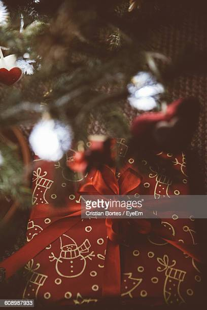 high angle view of christmas present on table - bortes stock pictures, royalty-free photos & images