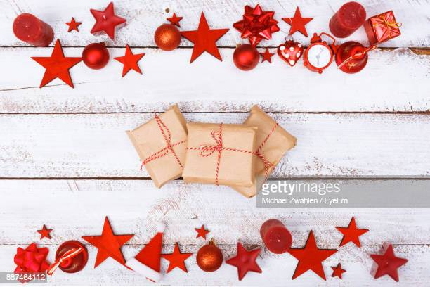 High Angle View Of Christmas Presents And Decorations On Table