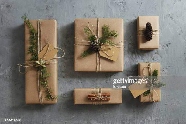 high angle view of christmas presents - brown paper stock pictures, royalty-free photos & images