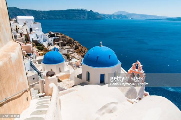 high angle view of church at seaside - cyclades islands stock pictures, royalty-free photos & images