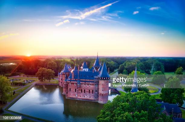 high angle view of church by river against sky during sunset - utrecht stockfoto's en -beelden