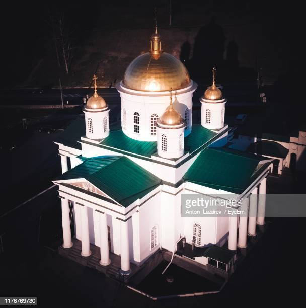 high angle view of church in city at night - nizhny novgorod stock pictures, royalty-free photos & images