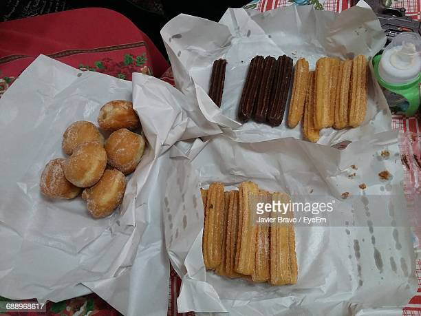 High Angle View Of Churros In Paper