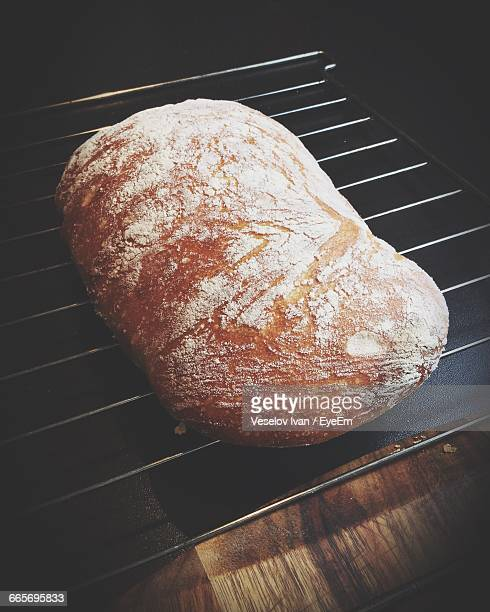 High Angle View Of Ciabatta On Metal Grate In Kitchen