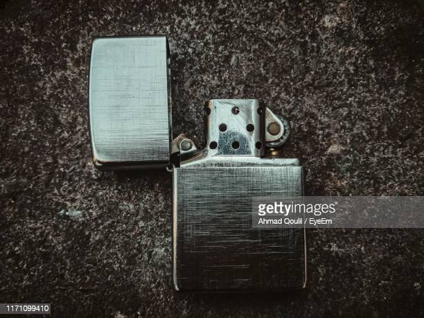 high angle view of cigarette lighter - cigarette lighter stock pictures, royalty-free photos & images