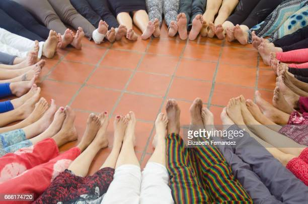 high angle view of circle of bare feet of people - beautiful male feet stock photos and pictures