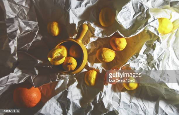 high angle view of citrus fruits on table - liga cerina stock pictures, royalty-free photos & images