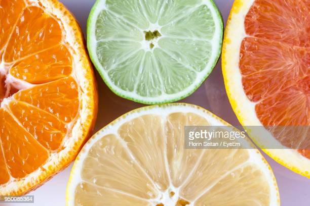 High Angle View Of Citrus Fruits Over White Background