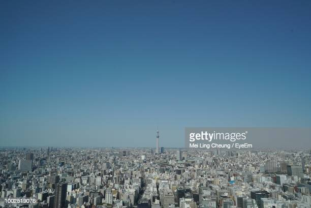 high angle view of city against blue sky - townscape stock pictures, royalty-free photos & images