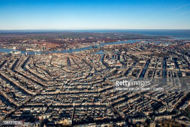 high angle view of city against clear sky - amsterdam stock-fotos und bilder