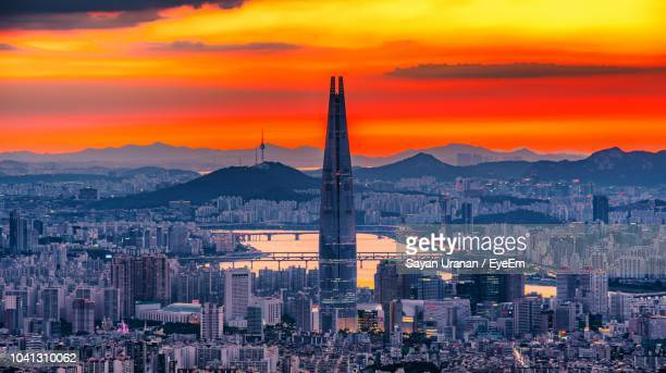 high angle view of city against cloudy sky during sunset - ソウル ストックフォトと画像