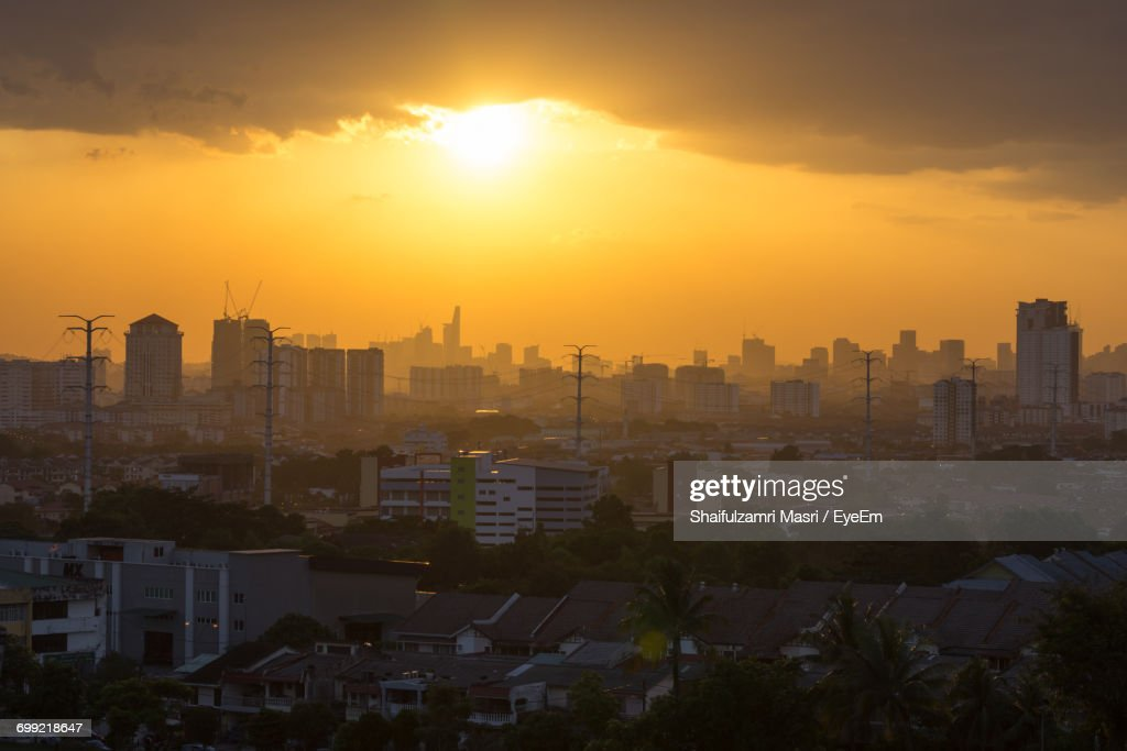 High Angle View Of City Against Cloudy Sky : Stock Photo