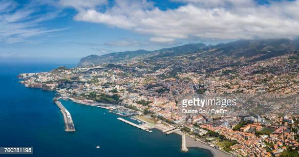 high angle view of city against cloudy sky - funchal stock pictures, royalty-free photos & images