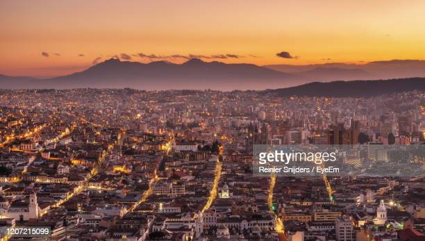 high angle view of city against sky during sunset - ecuador fotografías e imágenes de stock