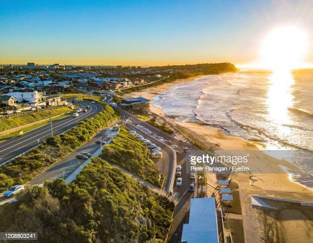 high angle view of city against sky during sunset - newcastle new south wales stock pictures, royalty-free photos & images