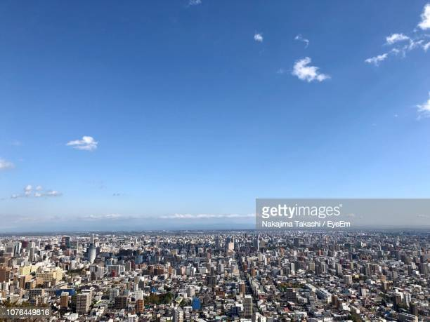 high angle view of city against sky - sapporo japan stock pictures, royalty-free photos & images