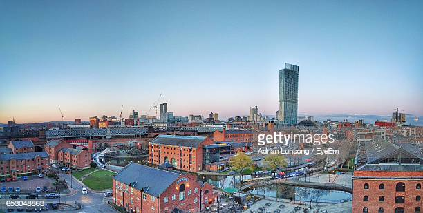 high angle view of city against sky - manchester uk stock photos and pictures