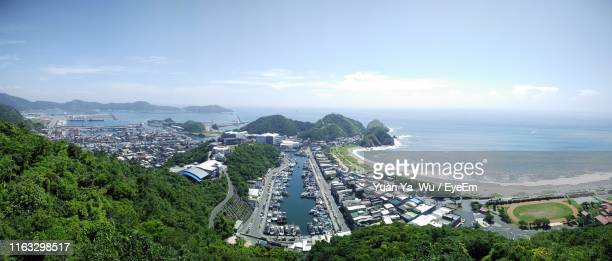 high angle view of city and sea against sky - flowing cape stock pictures, royalty-free photos & images