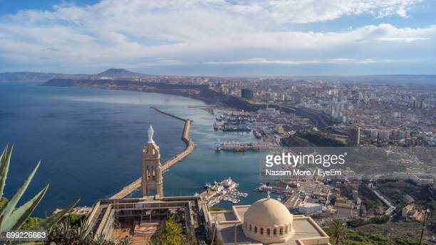 high angle view of city at seaside - oran algeria photos et images de collection