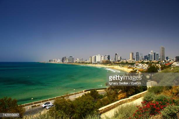 high angle view of city at seaside - tel aviv stock pictures, royalty-free photos & images