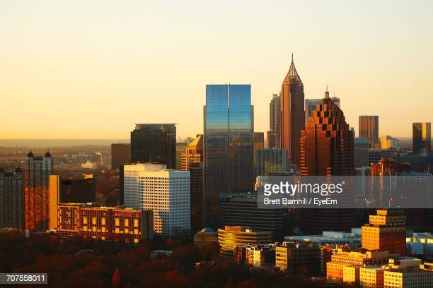 high angle view of city at sunset - atlanta stock photos and pictures