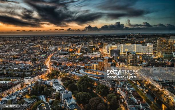 high angle view of city at sunset - the hague stock photos and pictures