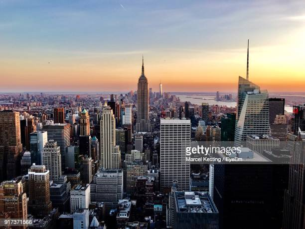high angle view of city at sunset - new york skyline stock photos and pictures