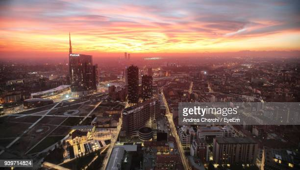 high angle view of city at sunset - milano foto e immagini stock