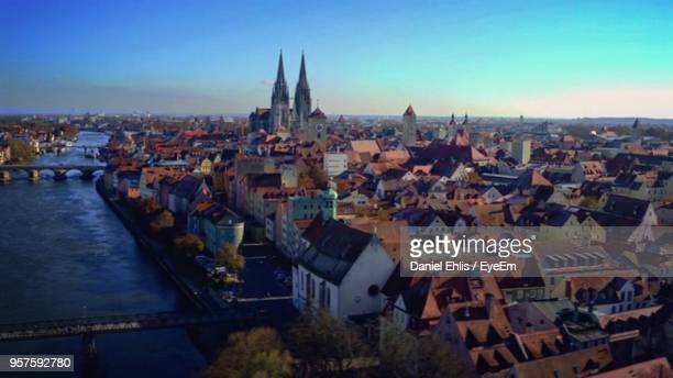 high angle view of city at sunset - regensburg stock photos and pictures