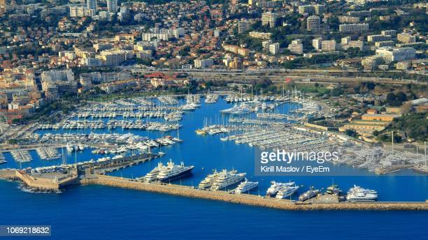 high angle view of city at waterfront - antibes fotografías e imágenes de stock