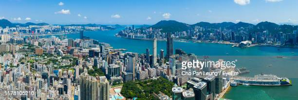 high angle view of city at waterfront - tsim sha tsui stock pictures, royalty-free photos & images