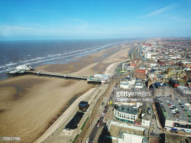 high angle view of city at waterfront - blackpool stock photos and pictures