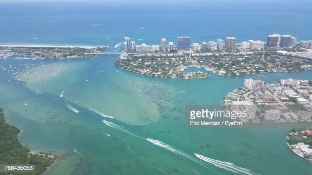 high angle view of city at waterfront - miami dade county stock photos and pictures