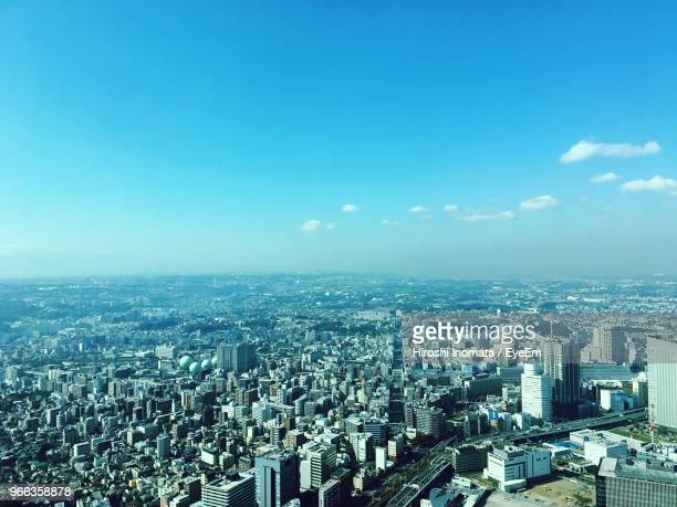 high angle view of city buildings against blue sky - 都市 ストックフォトと画像