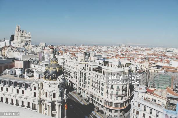 high angle view of city buildings against clear sky - madrid stock-fotos und bilder