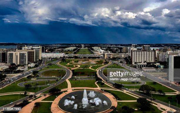 high angle view of city buildings against cloudy sky - distrito federal brasilia stock pictures, royalty-free photos & images